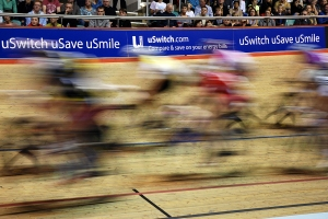 Bikes racing past uSwitch sponsorship signs at Manchester Velodrome